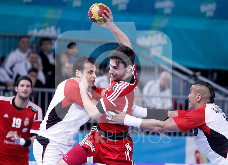 Hungary's Mate Lekai (c) and Egypt's Mohamed Ahmed (l) and Mohamed Mamdouh during 23rd Men's Handball World Championship preliminary round match.January 12 ,2013. (ALTERPHOTOS/Acero)