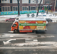 A Fresh Direct hybrid truck making deliveries in Chelsea in New York on Sunday, January 8, 2017. Online retailers such as Fresh Direct and Amazon for example are finding that brick and mortar supermarkets who have an online presence have an average e-commerce shopping cart between $120 and $180 compared to $105 and $84 for Amazon. Grocery spending accounts for 19% of all consumer spending but only 2% online. The figures are from Brick Meets Click a consultancy firm. (© Richard B. Levine)