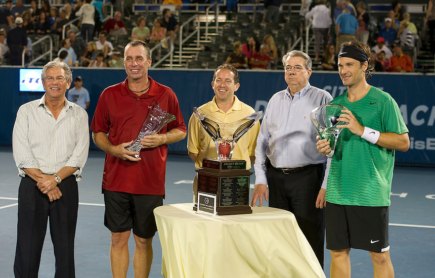 Carlos Moya (ESP) celebrates with the trophy after his victory over Ivan Lendl (USA) in their Final match today - Carlos Moya (ESP) def Ivan Lendl (USA) 6-4 6-4..Tennis - 2012 ATP Champions Tour - Day 5 - Tuesday 28 February 2012 - Delray Beach Stadium & Tennis Center - Delray Beach - Florida - USA ..