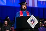 Sanjay Gidwani, Class of 2003, reads the alumni induction Sunday, June 11, 2017, during the DePaul University College of Computing and Digital Media and the College of Communication commencement ceremony at the Allstate Arena in Rosemont, IL. (DePaul University/Jamie Moncrief)