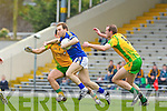 Darran O'Sullivansprints past the swarm defence of Donegal's Frank McGlynn and Neil Gallagher during their Allainz league clash in Fitzgerald Stadium on Sunday