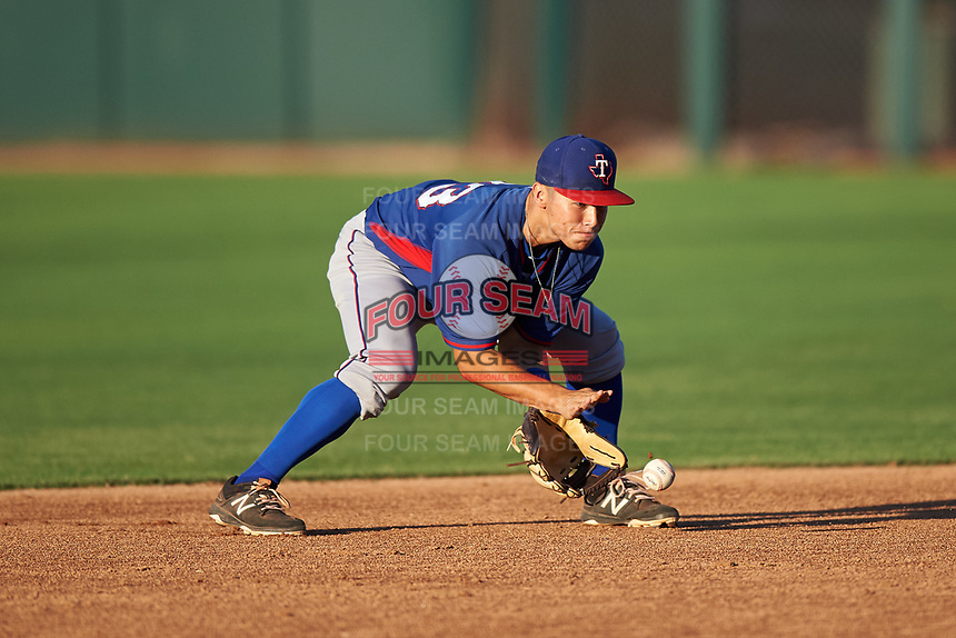AZL Rangers shortstop Cody Freeman (33) fields a ground ball during an Arizona League game against the AZL Athletics Gold on July 15, 2019 at Hohokam Stadium in Mesa, Arizona. The AZL Athletics Gold defeated the AZL Rangers 9-8 in 11 innings. (Zachary Lucy/Four Seam Images)