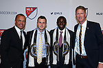 14 January 2016: Joshua Yaro (GHA) (second from right) was selected with the #2 overall pick, and Keegan Rosenberry (second from left)) was taken #3, both by the Philadelphia Union. They are flanked by technical director Earnie Stewart (left) and head coach Jim Curtin (right). The 2016 MLS SuperDraft was held at The Baltimore Convention Center in Baltimore, Maryland as part of the annual NSCAA Convention.