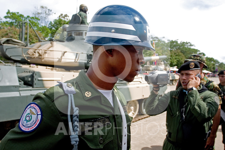 "Venezuelan soldiers watch a military parade in Valencia, Venezuela, on Saturday, June 24, 2006. The military parade was to celebrate Army Day and took place in ""Campo de Carabobo"", the field where the last big battle for the Venezuelan independence was won. (ALTERPHOTOS/Alvaro Hernandez)."