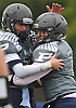Plainview JFK quarterback No. 7 Kevin Pastier, right, gets congratulated by teammate No. 44 Brendan Fitzpatrick after scoring a touchdown on a keep in the second quarter of a Nassau County Conference I varsity football game against Port Washington at Plainview JFK High School on Saturday, October 3, 2015. Plainview JFK went on to win by a score of 42-0.<br /> <br /> James Escher
