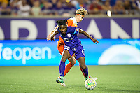 Orlando, Florida - Saturday, April 23, 2016: Orlando Pride forward Jasmyne Spencer (23) avoids the challenge of Houston Dash defender Rebecca Moros (4) during an NWSL match between Orlando Pride and Houston Dash at the Orlando Citrus Bowl.