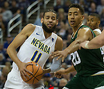 Nevada's Cody Martin, left is guarded by Colorado State's Deion James in the first half of an NCAA college basketball game in Reno, Nev., Sunday, Feb. 25, 2018. (AP Photo/Tom R. Smedes)