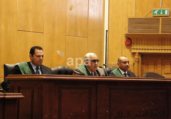 Judges attend the trial of defendants on case of  the deaths in a riot following a football match in Port Said in February 2012, in Cairo on May 24, 2015. According to reports the Egyptian court upheld 11 death sentences for defendants at their retrial in the case of 74 deaths in clashes between football fans in February 2012, though the sentences still need to be referred to Egypt's Grand Mufti and the verdict can be appealed. Photo by Stringer