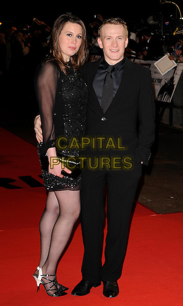 "GUEST & JAMIE PARKER .At the UK Film Premiere of ""Valkyrie"", Odeon Leicester Square, London, England, January 21st 2009..full length black dress suit .CAP/CAN.©Can Nguyen/Capital Pictures"
