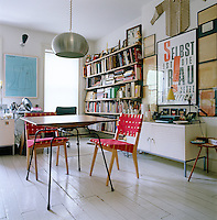 Graphic designer Carin Goldberg works from home and her studio is filled with books and artwork
