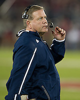 Brian Kelly watches from the sideline.