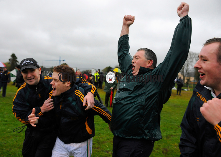 Manager Danny Chaplin celebrates with Tony Moloney, Niall Moloney and PJ Moroney at the final whistle following the Intermediate hurling county final at Clarecastle. Photograph by John Kelly.