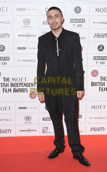 Adam Deacon .14th Moet British Independent Film Awards 2011, Old Billingsgate, Lower Thames Street, London, England, 4th December 2011.full length black suit   .CAP/BEL.©Tom Belcher/Capital Pictures.