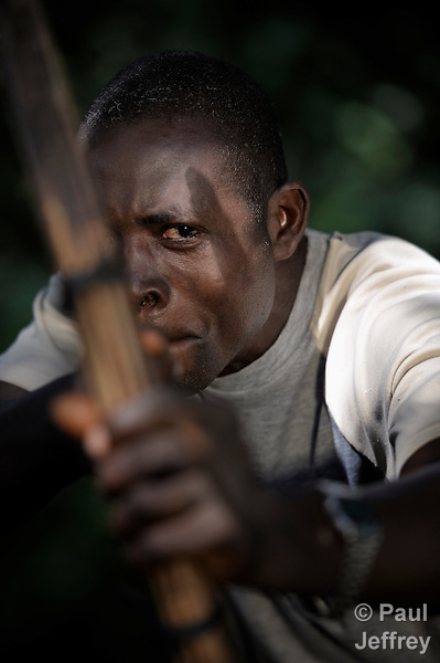 Simon Peter Gamana patrols the forest near his village of Riimenze, in Southern Sudan's Western Equatoria State, on the look out for the Lord's Resistance Army, which has displaced tens of thousands in recent months along the border area. Many believe the northern Sudan government is behind the attacks in its desire to destabilize the south in the period leading to a January 2011 referendum on secession. NOTE: In July 2011 Southern Sudan became the independent country of South Sudan.