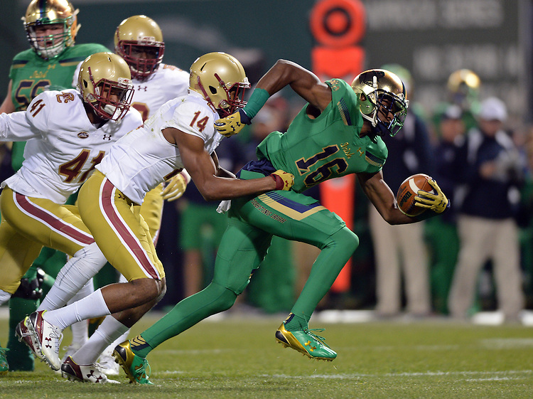 (Boston, MA, 11/21/15) Notre Dame's Torii Hunter, Jr., (16) right, is brought down by Boston College's Gabriel McClary during the first quarter as Notre Dame hosts Boston College at Fenway Park in Boston on Saturday, November 21, 2015. Photo by Christopher Evans