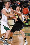 SPEARFISH, SD - DECEMBER 29:  Will John Johnson #32 of Black Hills State passes around UC-Colorado Springs defender Tommy Klausner #44 during their game at the Perkins Basketball Classic Tuesday at the Donald E. Young Center in Spearfish, S.D. (Photo by Dick Carlson/Inertia