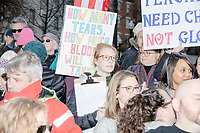 "People gather during the March For Our Lives protest and demonstration in Boston Common in Boston, Massachusetts, USA, on Sat., March 24, 2018. The march was held in response to recent school gun violence. Here, people hold signs reading ""How many tears, how much blood will it take?"""