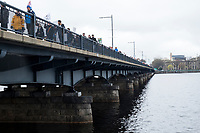 People march across the Harvard Bridge from Cambridge to Boston, Massachusetts, after rallying at MIT (campus at rear right) during the March for Science demonstration on Sat., April 22, 2017.