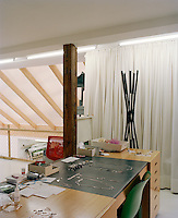 Jewellery designer Saskia Diez's desk with some of her pieces displayed