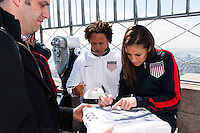 U.S. women national team midfielder Carli Lloyd autographs a 100th anniversary jersey on the observation deck of the Empire State Building during the centennial celebration of U. S. Soccer in New York, NY, on April 05, 2013.