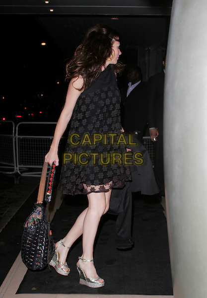 ANNA FRIEL.Attends Suka, An evening at Sanderson in aid of CLIC Sargent, The Sanderson, Berners Street,.London, England, May 15th 2007..full length black flower print dress bag gold wedges shoes  side profile.CAP/AH.©Adam Houghton/Capital Pictures.