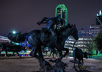 Pioneer Park in downtown Dallas has this wonderful bronze statues the depict the cattle drives of the 19th century along the Shawnee Trail that might of come through Dallas with the longhorns and cowboy trail rider guiding the herd with the city skyline in the background.