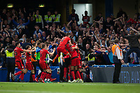 Huddersfield Town's Laurent Depoitre (obscured) celebrates with team mates after scoring the opening goal <br /> <br /> Photographer Craig Mercer/CameraSport<br /> <br /> The Premier League - Chelsea v Huddersfield Town - Wednesday 9th May 2018 - Stamford Bridge - London<br /> <br /> World Copyright &copy; 2018 CameraSport. All rights reserved. 43 Linden Ave. Countesthorpe. Leicester. England. LE8 5PG - Tel: +44 (0) 116 277 4147 - admin@camerasport.com - www.camerasport.com