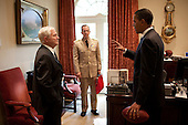 Washington, DC - June 16, 2009 -- United States President Barack Obama talks with Secretary of Defense Robert Gates, left, and Chairman of the Joint Chiefs of Staff Admiral Mike Mullen, U.S. Navy, center, outside the Oval Office in the White House, June 16, 2009. .Mandatory Credit: Pete Souza - White House via CNP