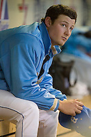 Gerrit Cole #12 of the UCLA Bruins on the bench between innings versus the Baylor Bears  in the 2009 Houston College Classic at Minute Maid Park February 28, 2009 in Houston, TX.  The Bears defeated the Bruins 5-1. (Photo by Brian Westerholt / Four Seam Images)