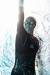 ENCINITAS, CA- APRIL 22 :  Model poses in Xterra Wetsuit on location in Encinitas, CA  (Photo by Donald Miralle)