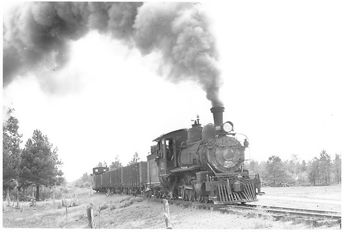 RGS #20 with four gondolas and a caboose between Ute Junction and Fort Lewis at MP 147.7.<br /> RGS  Ft. Lewis, CO  Taken by Peyton, Ernie S. - 8/1951