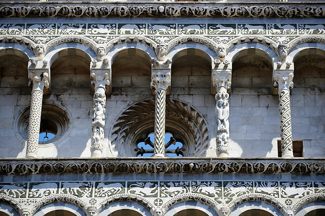 Close up of the Arcades of St Michele of the 13th century Romanesque facade of the San Michele in Foro,  a Roman Catholic basilica church in Lucca, Tunscany, Italy