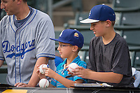 Fans wait for the players to sign autographs when the Salt Lake Bees played the Oklahoma City Dodgers in Pacific Coast League action at Smith's Ballpark on May 27, 2015 in Salt Lake City, Utah.  (Stephen Smith/Four Seam Images)