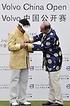 SUZHOU, CHINA - APRIL 18:  Y.E. Yang (L)  of Korea receives a Chinese gold jacket from Dr. Alexander Klose, President of Volvo Cars China, after winning the Volvo China Open on April 18, 2010 in Suzhou, China. Photo by Victor Fraile / The Power of Sport Images
