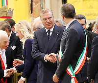 The mayor of Naples Luigi De Magistris and Prince Carlo of Borbone , governator of Campania shakes the hands  during  the liquefaction of the blood of San Gennaro, the patron saint of Naples, during the San Gennaro miracle announcement in the cathedral of Naples, 19 September 2016