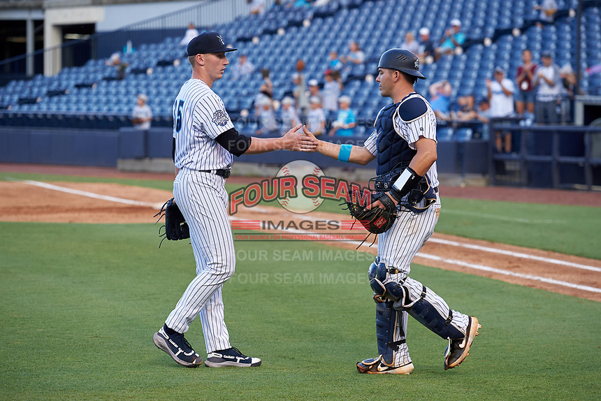 Tampa Tarpons pitcher Trevor Stephan (35) shakes hands with catcher Donny Sands (33) after closing out a Florida State League game against the Jupiter Hammerheads on July 26, 2019 at George M. Steinbrenner Field in Tampa, Florida.  Stephan struck out 9 batters over 7 innings for a no-hitter in the first game of a doubleheader.  Tampa defeated Jupiter 2-0.  (Mike Janes/Four Seam Images)