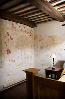 """The main feature of the house is a scheme of 16th century wall paintings in the upper rooms described by Sir Nikolaus Pevsner as """"a rare English interpretation of French verdure tapestries"""""""