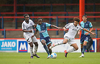 Marcus Bean of Wycombe Wanderers holds off Manny Oyeleke (left) & Luca Wightman of Aldershot Town during the pre season friendly match between Aldershot Town and Wycombe Wanderers at the EBB Stadium, Aldershot, England on 22 July 2017. Photo by Andy Rowland.
