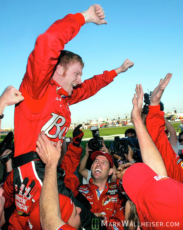 Dale Ernhardt Jr. raises his hands in victory after winning the 46th annual Daytona 500 NASCAR race at the Daytona International Speedway in Daytona Beach, Florida February 15, 2004. The win was Ernhardt Jr's first Daytona 500 victory.