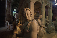 Virtue statue, on the funerary monument of Louis XII, 1462-1515, and Anne of Brittany, 1477-1514, made 1516-31 in Carrara marble by Giovani di Giusto Betti, 1479-1519, in the Basilique Saint-Denis, Paris, France. The mausoleum resembles an antique temple and is surrounded by the 12 apostles and the 4 cardinal virtues, Prudence, Might, Justice and Temperance and the plinth is decorated with bas-reliefs of the Italian wars. The basilica is a large medieval 12th century Gothic abbey church and burial site of French kings from 10th - 18th centuries. Picture by Manuel Cohen
