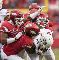 Hawgs Illustrated/BEN GOFF <br /> Arkansas defenders tackle Jesse Jackson (28), Mississippi State wide receiver, in the first quarter State Saturday, Nov. 18, 2017, at Reynolds Razorback Stadium in Fayetteville.