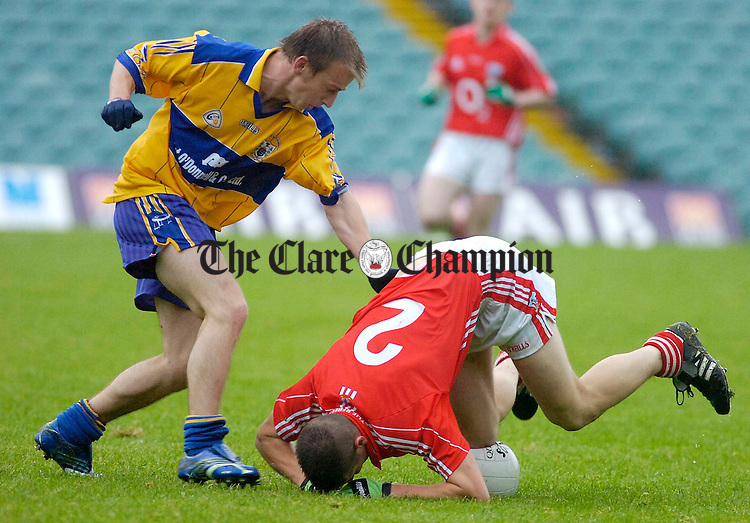 Clares Declan Callinan pressures Corks Barry Gogan during their Junior Football match at the Gaelic Grounds Limerick.Pic Arthur Ellis.