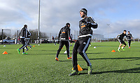 SWANSEA, WALES - JANUARY 28: Gylfi Sigurdsson (C) and other players warm up during the Swansea City Training Session on January 28, 2016 in Swansea, Wales.