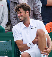 London, England, 27 june, 2016, Tennis, Wimbledon, Robin Haase (NED) falls on the grass and hutrs his knie in his match against Diego Schwartzman (ARG)<br /> Photo: Henk Koster/tennisimages.com