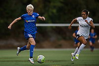 Seattle, Washington -  Sunday, September 11 2016: Seattle Reign FC forward Megan Rapinoe (15) drives down the right flank during a regular season National Women's Soccer League (NWSL) match between the Seattle Reign FC and the Washington Spirit at Memorial Stadium. Seattle won 2-0.