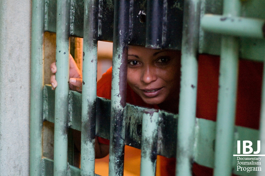 A woman says hello from the one jail cell in a prison twice over capacity just outside of Divinopolis, Brazil. 2008 JusticeMaker Dr. Aziz Saliba, based out of Divinopolis, is creating educational DVDs on habeas corpus and the Inter-American Court.