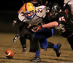 HOWARD, SD - NOVEMBER 8:  Logan McConnell #21 from Alcester Hudson battles for the loose ball with Bailey Neises #45 from Howard in the first half of their Class 9A Semifinal game Saturday night in Howard. (Photo by Dave Eggen/Inertia)