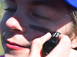 Gloria Tellier, 11, of Suffield has eye black applied under her eyes, Saturday, April 21, 2018, during the opening day of Suffield little league. (Jim Michaud / Journal Inquirer)