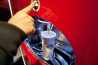 "Customer uses self-service drink machine at the new Steak 'n Shake Signature restaurant in New York on its grand opening day, Thursday, January 12, 2012. The popular midwest chain opened its first New York outpost with a new concept for the restaurant, a smaller footprint and counter-only service, hence their ""Signature"" branding. Founded in 1934 the company has nearly 500 restaurants with this one in New York being next to the Ed Sullivan Theatre where the Late Show with David Letterman Show is taped. © Richard B. Levine)"