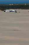 Long distance vertical shot of RVs on the dunes